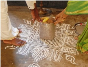 Nadu Veetu Kolam created with the traditionally used rice paste by a Nagarathar woman in Chennai (photo 1 by Kala Shreen)