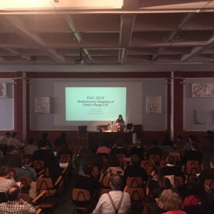 A distance shot of Eleanor Betts, talking about Ostia and the Senses
