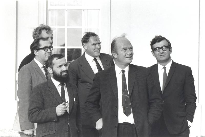 Pioneers of the OU: showing (from left to right) Mike Pentz, first Dean of Science; Geoffrey Holister, first Dean of Technology; Maxim Bruckheimer, first Dean of Mathematics; John Ferguson, first Dean of Arts; Walter Perry, first Vice-Chancellor; and Anastasias Christodoulou, first University Secretary.
