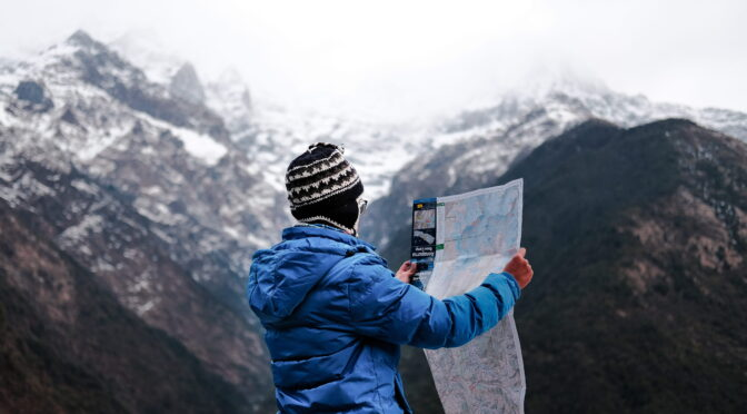 Image of mountaineer reading a map