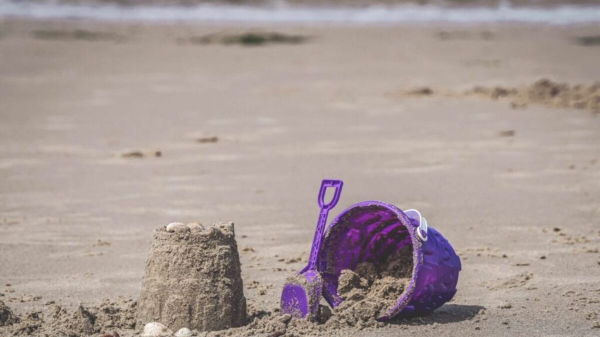 Bucket and sandcastle on a beach