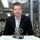 Dr Geraint Morgan, The Open University, with a mass spectrometer.