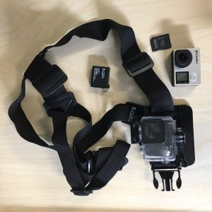 The Go Pro Kit, showing the camera, batteries and shoulder strap.