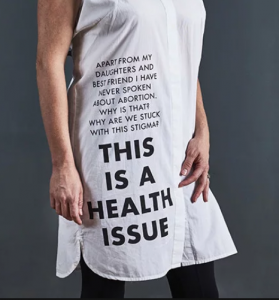 This is a health issue; stories are printed on items of clothing, in this case a T-shirt.