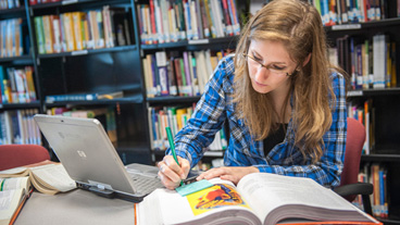Student working in Open University library