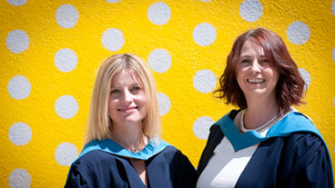 Open University students at a graduation ceremony in Milton Keynes