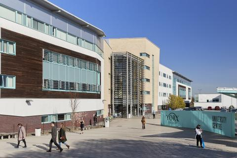 Image of YC University Centre, showing modern buildings with students outside