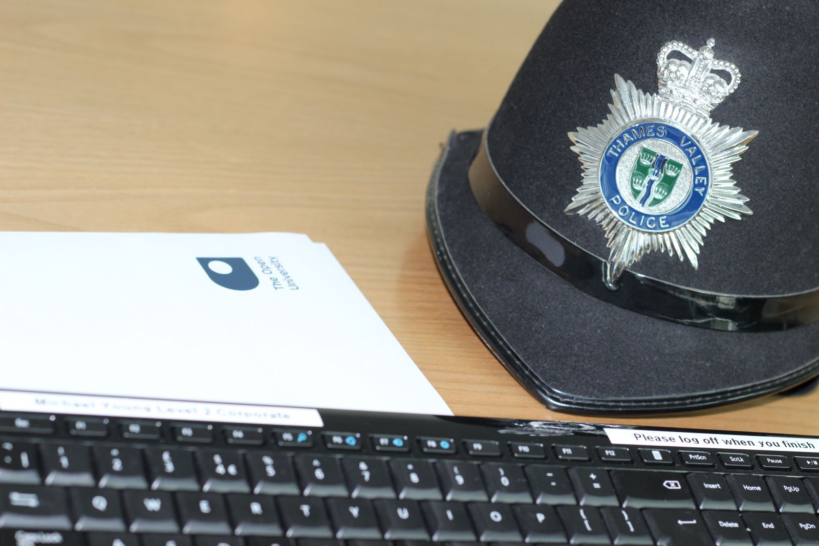 Police hat and OU document