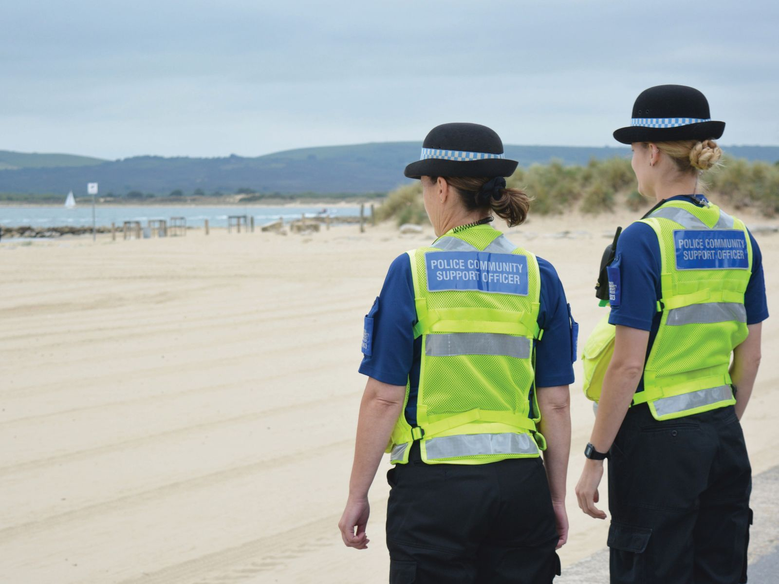 Police women looking out to sea
