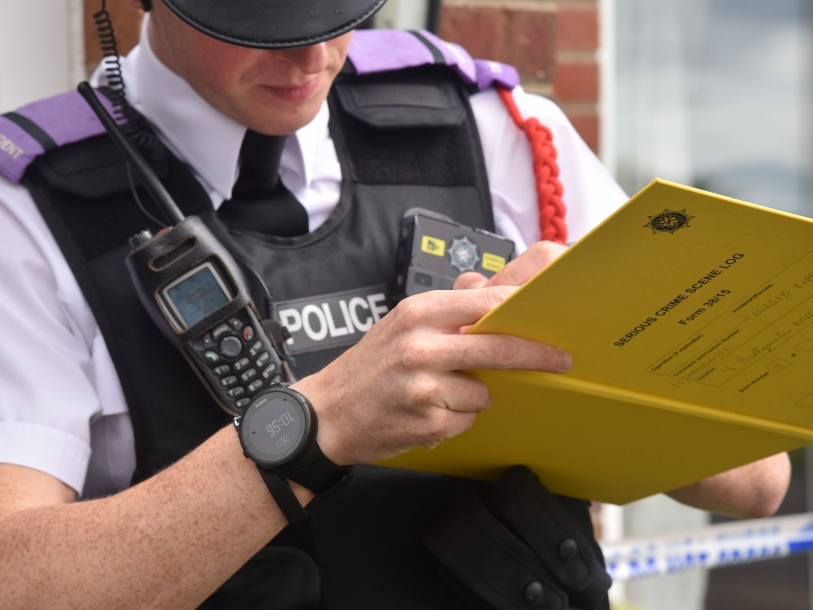 Policeman holding book