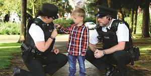 image of police officers talking to child