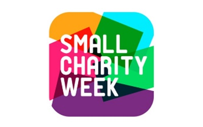 Photo of the Small Charity week logo which is brightly coloured with splashes of yellow, red, pink, green, blue and purple