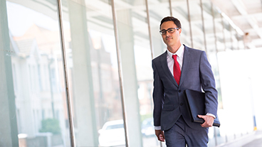 4a3e7fb3bd8 Solicitor walking to meeting