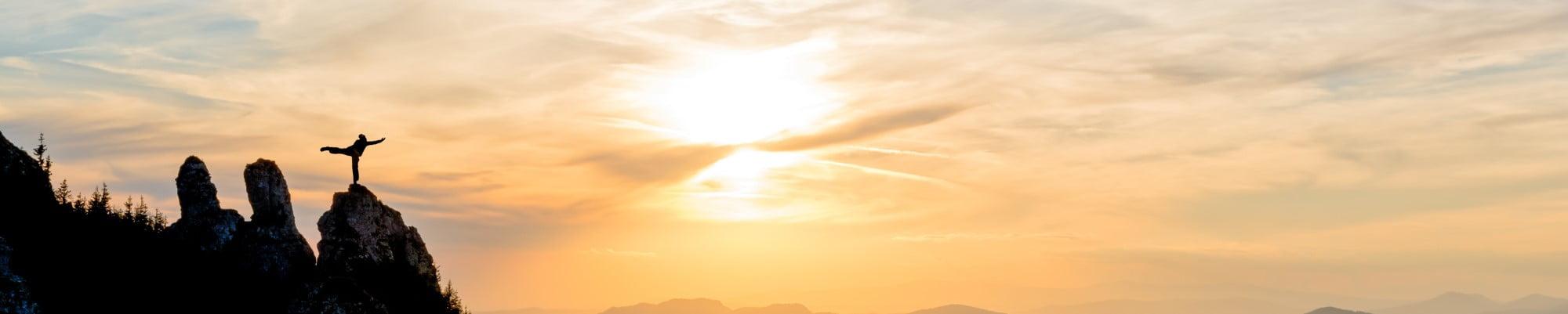 Girl doing yoga at sunrise