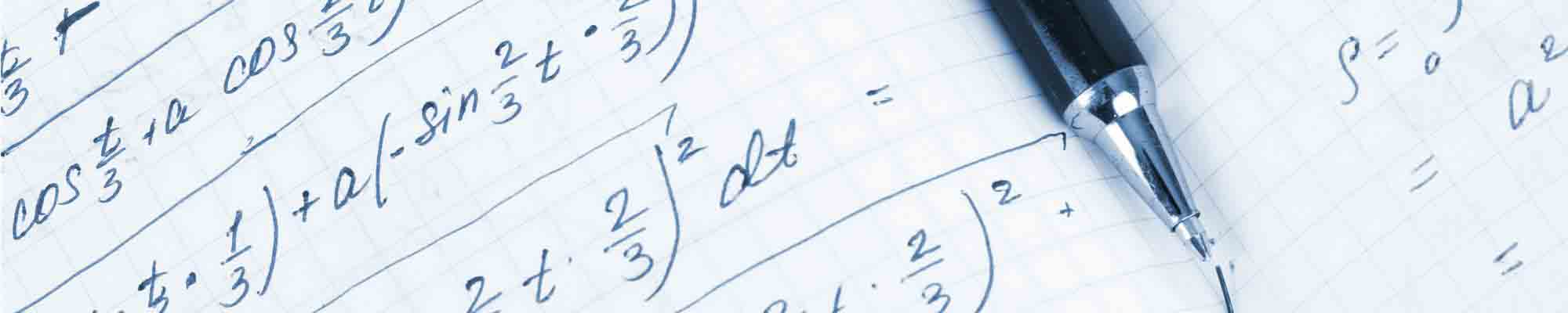 Hand-written mathematical calculations on squared paper