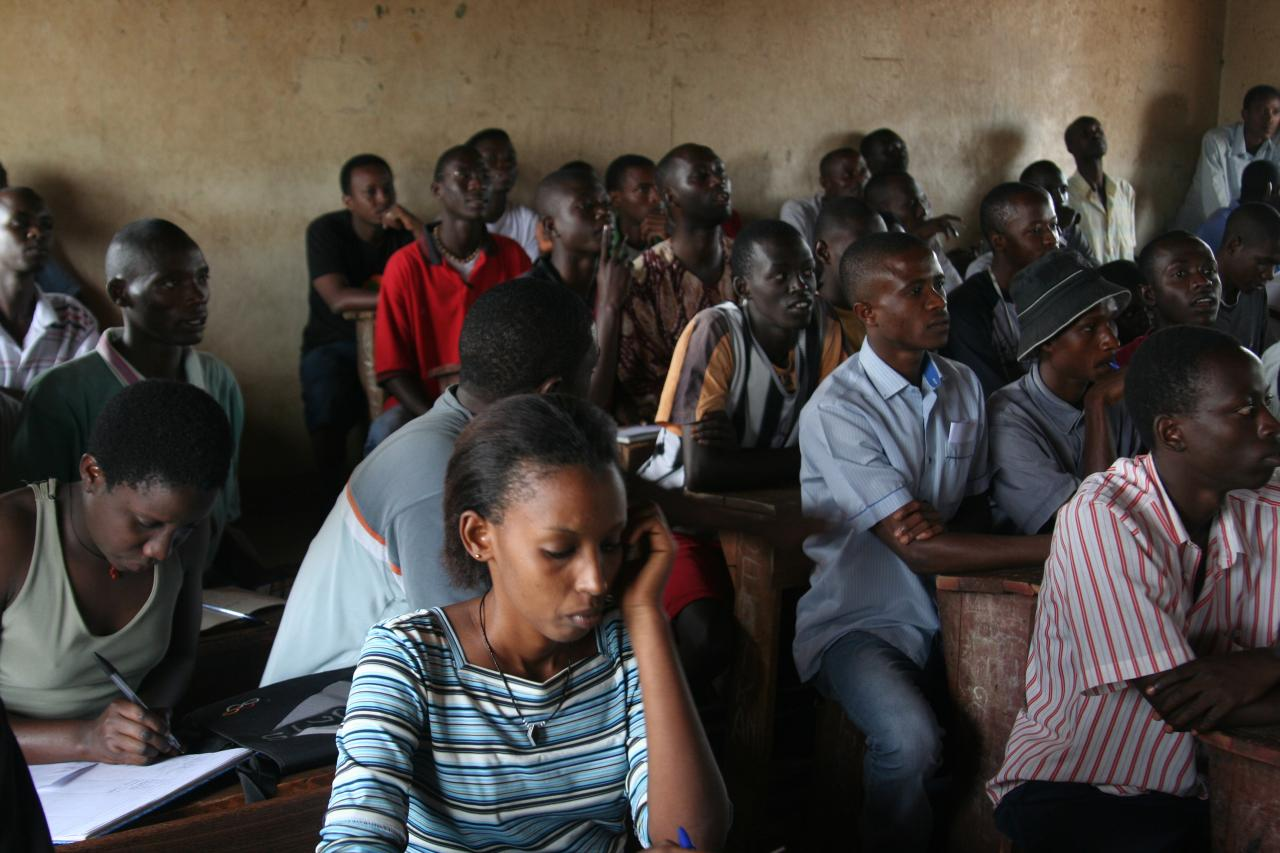 Image of a group of adults learning in a classroom in Burundi, taken January 2009