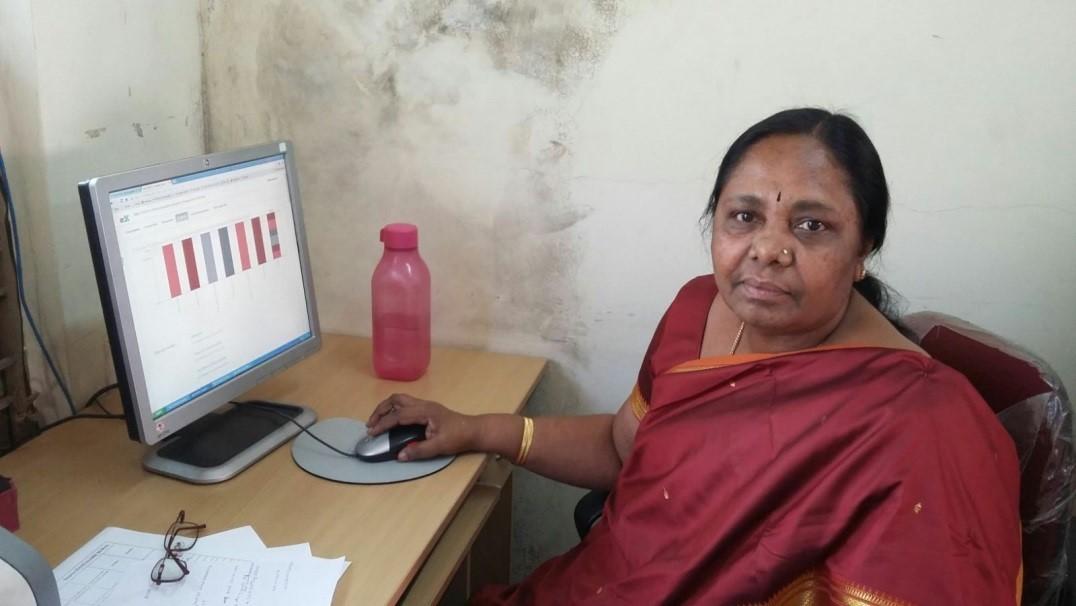 Senior Lecturer of DIET Bangalore Rural, Karnataka, using a computer to undertake the MOOC
