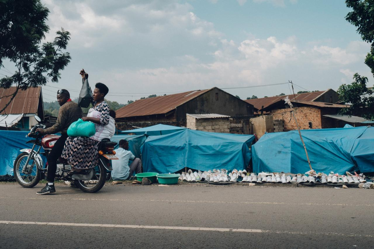 Lady on the back of a motorbike with her baby. Photo by Random Institute on Unsplash