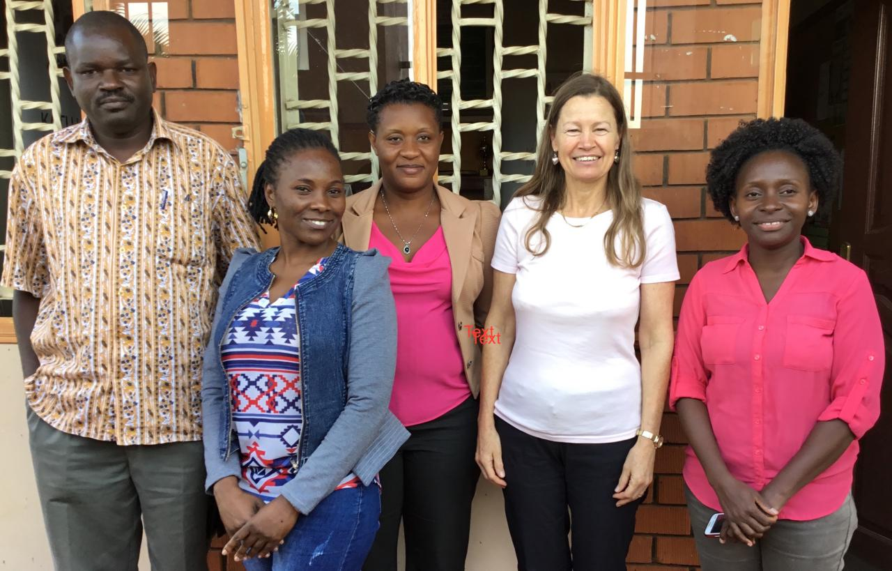 Photo of Commonwealth Scholars from earlier years with OU tutor