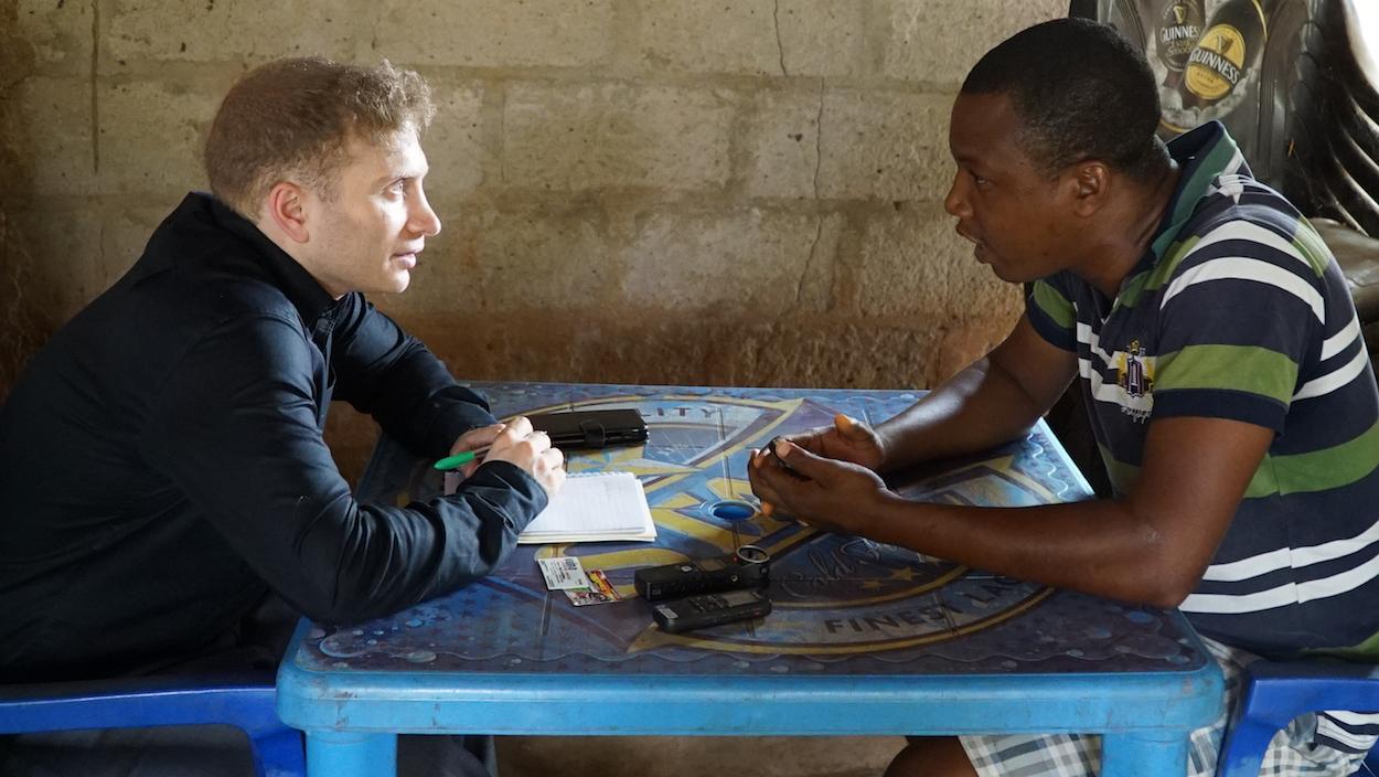 Photo of Alex interviewing set designer Ike