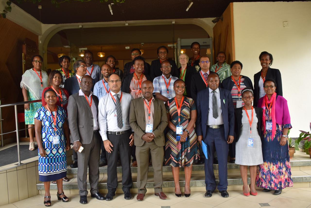 The KEMRI Deputy Director, Research, Dr Evans Amukoye, joins a group photograph of workshop participants