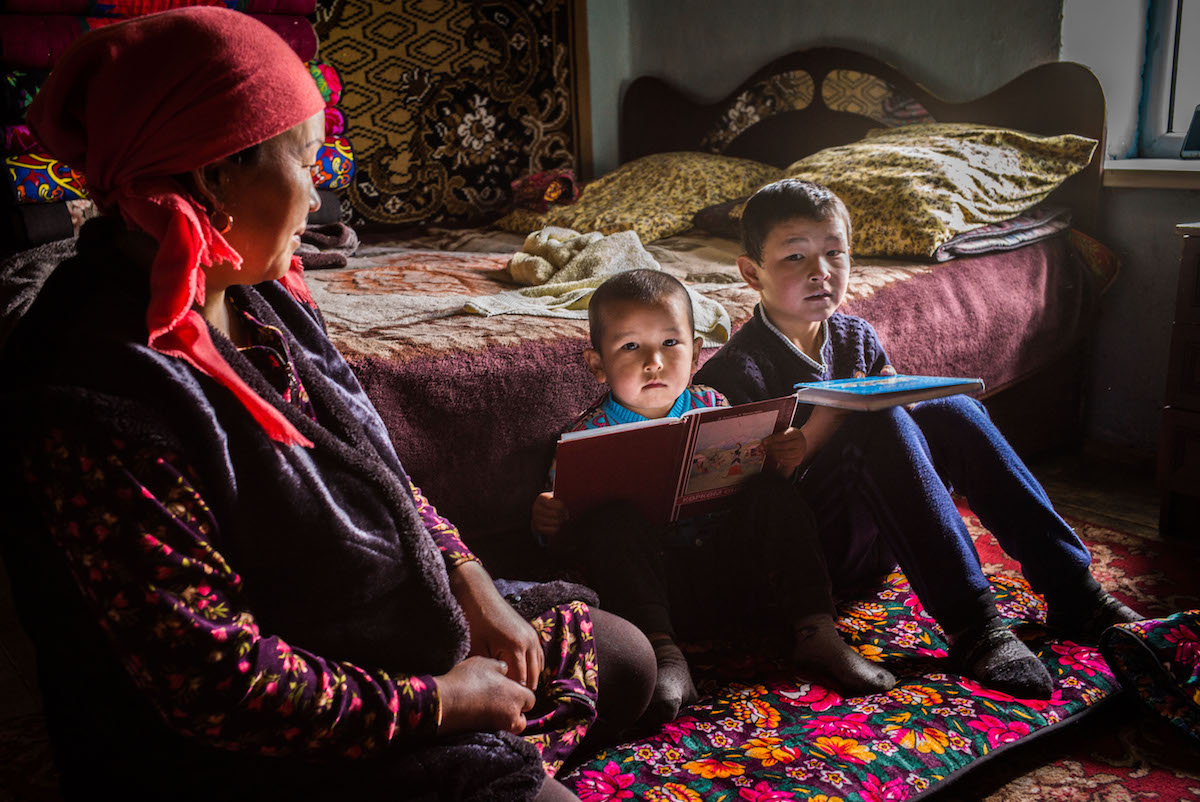 Photo by John Oates of Kyrgyz family at home