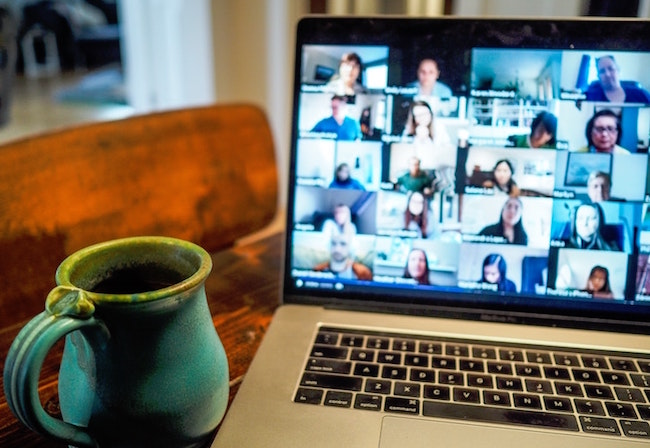 Photo of laptop screen displaying online meeting attendees