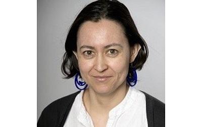 Photo shows Dr Helena Pérez Niño wearing a white top and a black cardigan