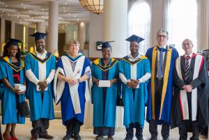 Environmental graduates and Open University academics pictured at ceremony