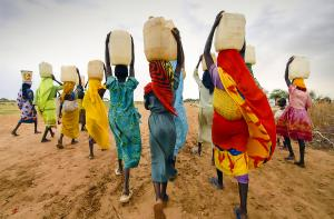 Photo of women in Tanzania carrying water jars