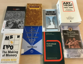 Photograph of a group of notable OU research books