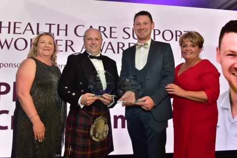 Colette Baker, LV, Craig Chambers and Philip Martin, winners of the Health Care Support Worker Award and Janice Smyth, Director of the RCN in Northern Ireland.