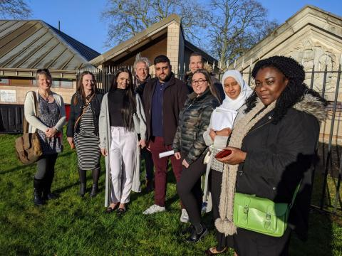 (photo – Roseline ( pictured first on the right), fellow students and tutor Kate Ritchie ( far left) in the HMP High Down grounds, March 2020)