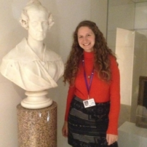 Brigitte Stenhouse next to a bust of Mary Somerville at the Royal Society, London.