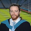Barry Ryan after the degree ceremony at Croke Park with the field in the background