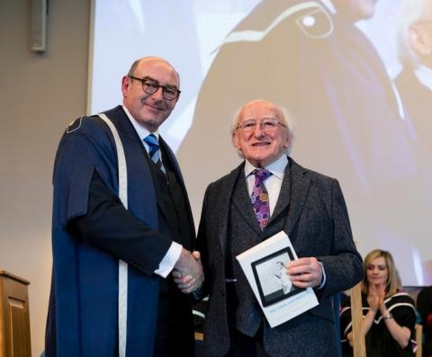 National Director of The Open University in Ireland, John D'Arcy, shaking hands at an OU degree ceremony with the President of Ireland Michael D Higgins