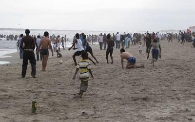 Photo of Chinese and Ghanaians playing football on a beach near Ghana's capital, Accra