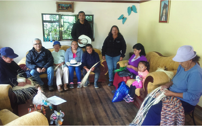 Dr Alexander Borda-Rodriguez on a recent research trip to Ecuador, surrounded by a group of workers weaving