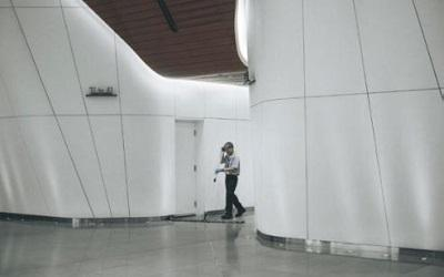 Photo of a male cleaning in an empty building