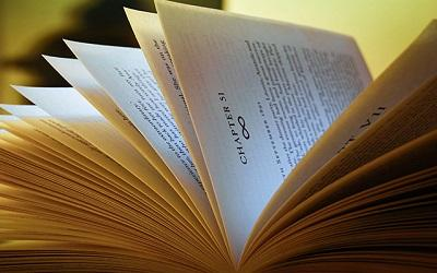 Image of an open book with the pages turning