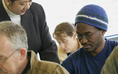 Male learner studying in a group environment