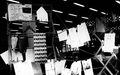 Photo of the exhibition itself, papers hanging up as described by Raktim