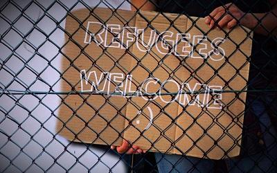A sign saying 'Refugees Welcome'