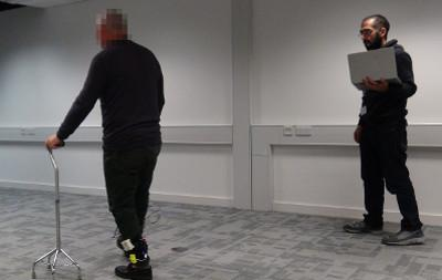 Man walking with haptic aids
