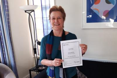 Jean Hartley with her award