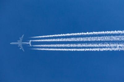 Some conspiracy theorists believe contrails are chemicals being sprayed for nefarious purposes. Shutterstock