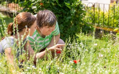mentally disabled woman in garden with carer
