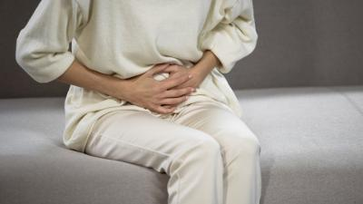 Lady suffering from stomach pain