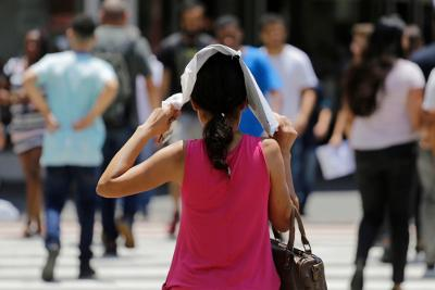 Woman protecting her head in the sun