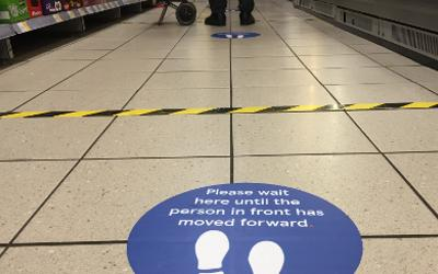 Social distancing guidelines in a supermarket